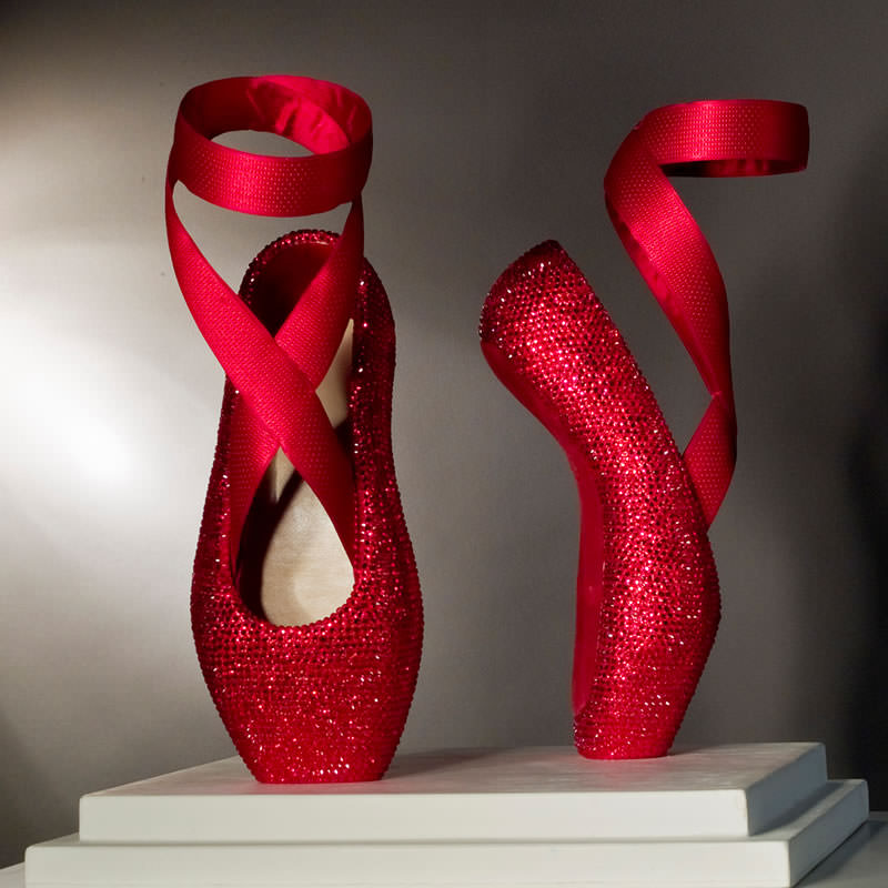 Sculpture with red shoes