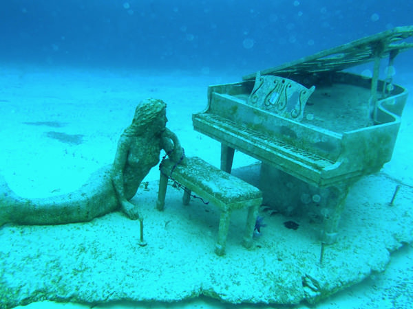 Mermaid and the Piano, placed in the water by David Copperfield, near his private island