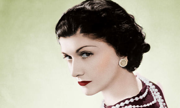 Coco Chanel with red lipstic